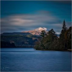 Loch Ard in blue with a dusting of white, Scotland