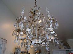White chandelier lighting w/ gold ceiling by AnitaSperoDesign