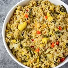 This flavorful Jamaican seasoned rice is easy to prepare with long grain brown rice callaloo ackee cabbage pumpkin carrot peas carrot in a seasoned coconut broth Vegan Rice Dishes, Rice Recipes Vegan, Brown Rice Recipes, Vegetarian Recipes, Dishes Recipes, Vegan Food, Crockpot Recipes, Recipies, Gourmet