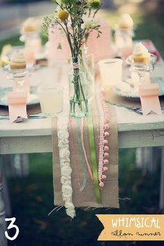 Could use ribbons as a runner, cheap and easy way to add the pop of colour you want to match your theme