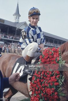 Kentucky Derby, Ron Turcotte victorious aboard Secretariat in Winner's circle with flowers at Churchill Downs, Louisville, KY 5/6/1973