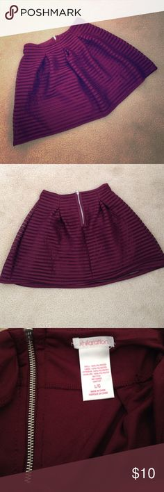 Super adorable Xhiliration skirt This skirt is a gorgeous wine color! I've only worn it a couple times, so it is in great condition! I've lost weight and it no longer fits. You can really dress this skirt up, I wore it to a fancy valentines dinner last year! It comes up and fits snug on your waist but then flairs out. Hits above the knee. Xhilaration Skirts Mini