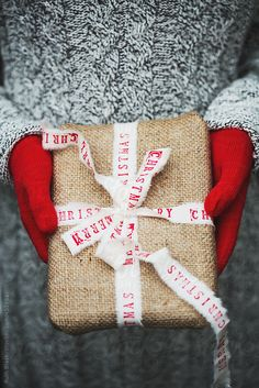 Hands holding Christmas gift by RuthBlack | Stocksy United