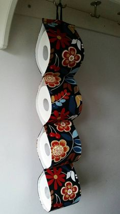 Check out this item in my Etsy shop https://www.etsy.com/listing/471766290/fabric-decorative-toilet-paper-holder
