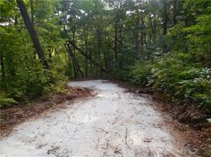 Nature surrounds this beautiful 4.98 ac lot with privacy and a new white gravel driveway. Hear the sounds of Clear Creek from this buildable lot.  The Georgian Highlands Subdivision features underground utilities and a very nice Gated Entrance.  Build that Custom Home here and enjoy the North Ga Mountains to the fullest.  Close to nature walking paths  Water and electric available at the beginning of Driveway.  Great Views and Hardwoods.  Priced Right!!