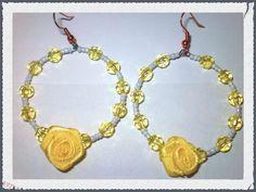 Bijoux handmade with love By Valery Orecchini creati con filo armonico decorati con perline da conteria e un piccola rosellina fatta a mano con semplice nastro!