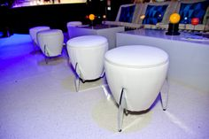 The all-white lounge furniture included rocket-ship-inspired ottomans at the Innovators' Ball. Photo: Josh Fee for BizBash