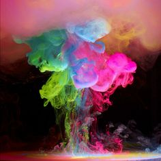 Bright Electric Ink Clouds Burst in Water