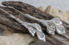 Hey, I found this really awesome Etsy listing at https://www.etsy.com/listing/177788451/silver-baby-calla-lily-twist-earrings