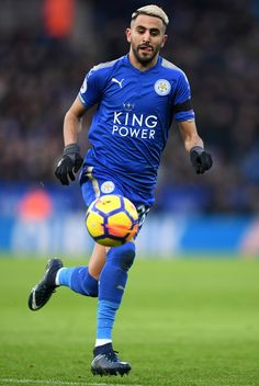 Riyad Mahrez of Leicester City runs with the ball during the Premier League match between Leicester City and Watford at The King Power Stadium on January 20, 2018 in Leicester, England.