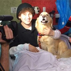 People around the world are coming together to share photographs of their dogs in order to put a smile on the face of Anthony Lyons, a 16-year-old boy who's currently battling leukemia. More than 500,000 photos have been shared so far.