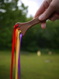 DIY A rainbow wand from an old paint brush handle.    For dancing