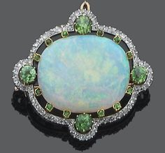 An opal, demantoid garnet and diamond brooch, circa 1900 The oval cabochon opal within a pierced circular-cut demantoid garnet surround and a rose-cut diamond border, mounted in silver and gold, French assay mark.
