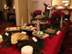 Stationary Display of Cheeses, Terrines, Pates, Sushi, Chicken and Beef Satay, and Crackers for a Holiday Party - Jules Catering