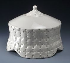 This handcrafted white on white clover leaf ceramic individual urn has an intricate repetitive stamped pattern that will intrigue you in the way it creates an optical illusion between positive and negative space. The clear glaze enhances the beauty of this pattern and the pure white porcelain. Find it at http://artisurn.com/collections/ceramic-urns/products/white-on-white-clover-leaf-ceramic-individual-urn #handcrafted #ceramic #pottery #urn