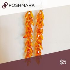 Orange Long Leaf Earrings Orange dangling earrings with a leaf effect. Other colors also available. Jewelry Earrings
