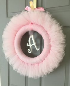 Please welcome Little Miss Tutu Shops newest addition! Personalized tulle wreaths. You select the colors! They make the perfect baby shower or birthday party decoration, and look beautiful hanging from the nursery door or wall. #tullewreath