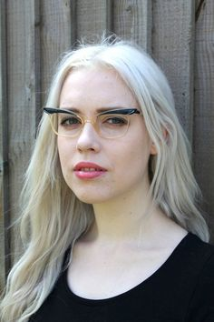 Pretty and elegant vintage 50s cat eye glasses frames. With classic two tone frame design - upper frame is navy and rest of frame and bridge is translucent. In good condition for their age and considering they have been worn previously. Our vintage glasses frames come without lenses. Your lenses of choice can be fitted at a good opticians. A delicate design that is best suited to smaller head sizes. Frame 14cm across. Arms can be adjusted to fit at an opticians if needed. We do our utmost…