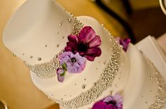 Purple and Pearls wedding cake. So pretty! Would love gerbera daisies on it!