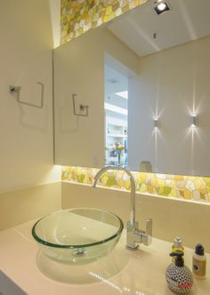 Powder Room - Light fixtures installed behind the mirror adding a soft defused light to the vibrant wall print..
