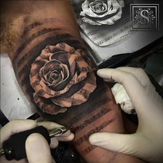 Black and grey style music staff rose. Tattoo artist: Sergio Fernández