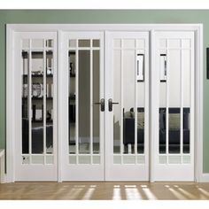 Delivery; 48 - 72 Hours and free anywhere on the UK mainland, Islands and exports by arrangement.    Doors shown are the W8, the smaller W6 model has the side lights to the left and right of the door pair but narrower with less glass, the W4 model does not have any side lights, the doors can also be purchased as a pair without any frame kit. W8 Manhattan Room divider doors would be supplied un-finished in white, they include the Frame lining kit but not the architrave.  Room ...