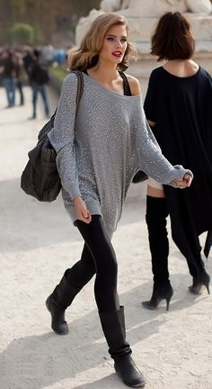 Constance Jablonski Fabulous Street Style : Glamorous grey oversized one-shoulder top over black leggings + casual boots