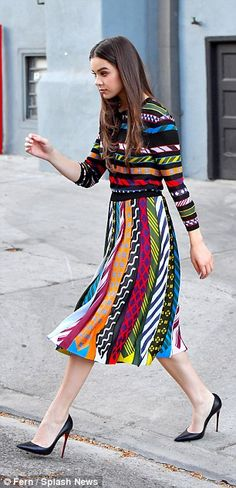 Pretty: The beauty cut a ladylike figure in a bold coloured dress she wore in Santa Monica...
