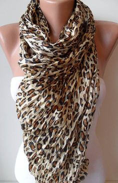 A big square Leopard scarf, I got a darker hue that is lovely with winter outfits, but I would love this on lighter background too for summer.