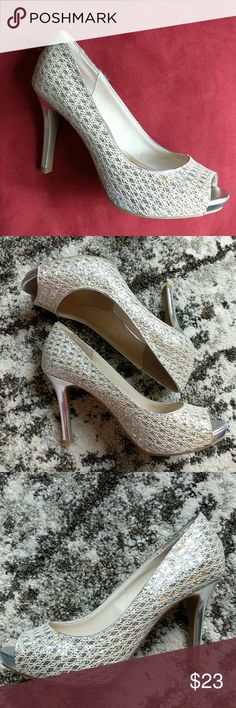 Silver and Cream Heels Add some sparkle to your day! These lovely heels are in excellent condition. Colors are silver and cream. There is a stain, which is shown in the past picture. I have added ball pads, but they are removable. Audrey Brooke Shoes Heels