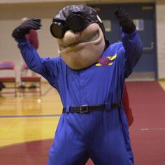 Rudy Flyer is the mascot of the Dayton Flyers. He is dressed in early pilots attire including a scarf and goggles.
