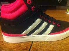Women's pink and black Adidas high tops hope u like them :)