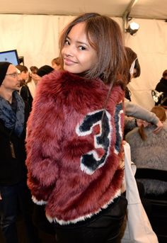 Faux fur and varsity in one jacket. We're in <3 with Malaika Firth at Tommy Hilfiger