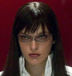 Milla Jovovich n somewhere idk (look that glasses? wtf? she slay)