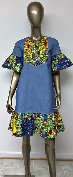 DENWAX Collection. Denim and African Print Shift Mini Dress. Sleeves. Side Pockets. Handmade. Womens. This is a beautiful above knee length African Print and denim Shift dress with short bell sleeves, slit open neckline, and side pockets. Ankara | Dutch wax | Kente | Kitenge | Dashiki | African print dress | African fashion | African women dresses | African prints | Nigerian style | Ghanaian fashion | Senegal fashion | Kenya fashion | Nigerian fashion | Ankara crop top (affiliate)