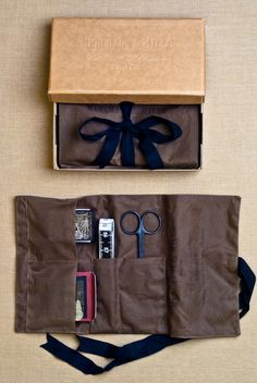 Oilskin Sewing Kit from Merchant & Mills: The Oilskin Sewing Kit is specially designed for the intrepid home sewist. This classic tailor's roll is made of tough British oilskin and is outfitted with some of Merchant & Mills' most indispensable tools: a box of Dressmaking Pins, a set of 25 Fine Sewing Needles, a Tape Measure and a pair of Wide Bow Scissors.