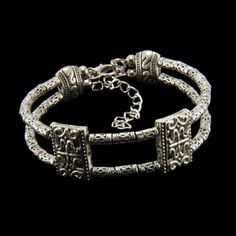 Add an antique accessory to any fashionable look with this ornate silver bangle bracelet. The metal comes with an oxidized finish and detail that looks carved. The lobster claw clasp will keep this attractive bracelet secure on your wrist.