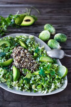 Mexican Brussel Sprout Slaw with a zesty Lime Dressing, quinoa, avocado and cilantro. Simple and tasty Recipe. Vegan and Gluten free!