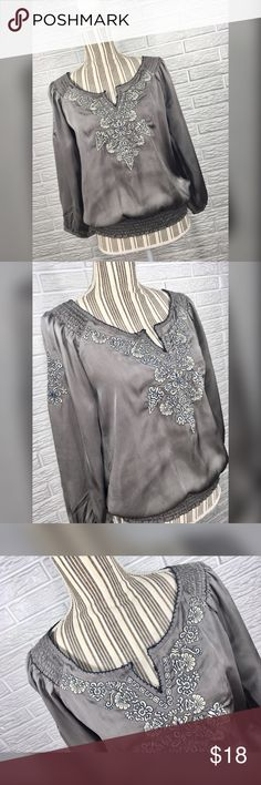 """{flying tomato} Embroidered Grey Peasant Top Satiny grey boho peasant top with tan and navy blue embroidery, ruched elastic trim, and 3/4 length sleeves by Flying Tomato. Size Medium.   Closure: No Closure  Material: 100% Polyester   Measurements  Bust: 38"""" lying flat, stretches to 39""""  Waist: 26"""" lying flat, stretches to 40"""" Shoulder to Hem Length: 22.5"""" Sleeve Length: 19"""" Flying Tomato Tops"""