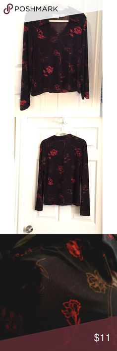 """Kathy Ireland Blouse Floral L 14 - 16 Kathy Ireland Blouse Floral L 14 - 16  Long sleeves, Collared V-neck, stretchy (13% spandex).   Colors: browns and orange. Measurements: Bust 21"""" (armpit to armpit), Length 25"""" (top of collar down), Sleeves 25"""" (shoulder seam down).  From a pet-free / smoke-free home. Kathy Ireland Tops Blouses"""