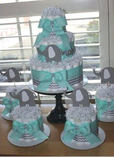 Elephant Diaper Cake Bundle Mint & Gray by EveryLittleDetailLLC (Diaper Cake Boy)I like the idea of doing one big diaper cake for Steph and a few little diaper cakes around it for decoration.Elegant budgeted baby shower diaper cakes Count me Idee Baby Shower, Baby Shower Cakes For Boys, Shower Bebe, Baby Shower Decorations For Boys, Baby Shower Themes, Baby Shower Gifts, Shower Ideas, Elephant Decorations, Elephant Baby Shower Centerpieces