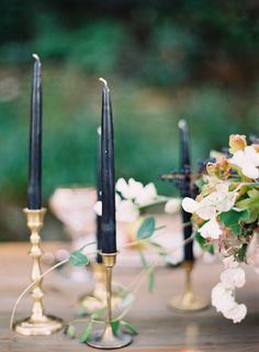 Moody Jewel Tones: Navy candles by Odalys Mendez via 100 Layer Cake