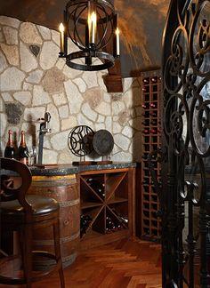 Victoria Lakeside Remodel - Vivid Interior. Wine room with custom French oak wine barrel and mahogany herringbone floors. #mahoganyfloor #winecellar