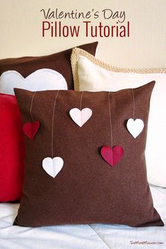 Round out your decorative holiday pillow collection with these charming DIY Valentine's Day heart-embellished pillows!