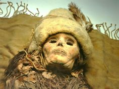 Clumps on the neck of this mummy from an ancient burial ground in the Chinese desert turned out to be ancient cheese, the oldest yet found.