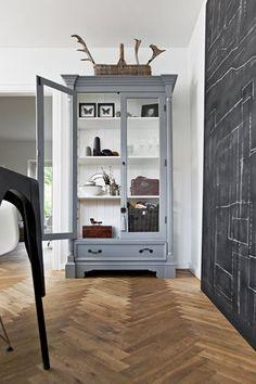 curio cabinet + chalkboard wall + herringbone floor