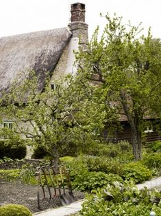 So English cottage-thatched roof and wonderful garden tools...