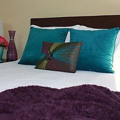 peacock bedroom idea! Exactly what I want. White comforter and the jewel Tone accents!