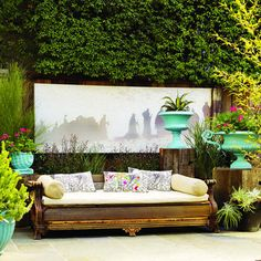 This landscape artist repurposed an antique couch into an outdoor daybed. She took away all of the reupholstery and then utilized recycled wood to create a new bench seat. Outdoor Sofa, Outdoor Seating, Outdoor Rooms, Outdoor Living, Outdoor Furniture, Outdoor Decor, Outdoor Art, Outdoor Cushions, Outdoor Fabric