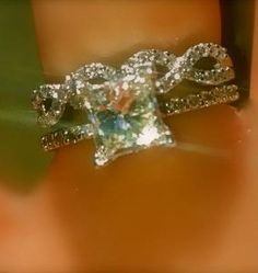 HE WENT TO JARED.  The engagement ring he proposed with and the wedding band... 1.5 princess cut :D